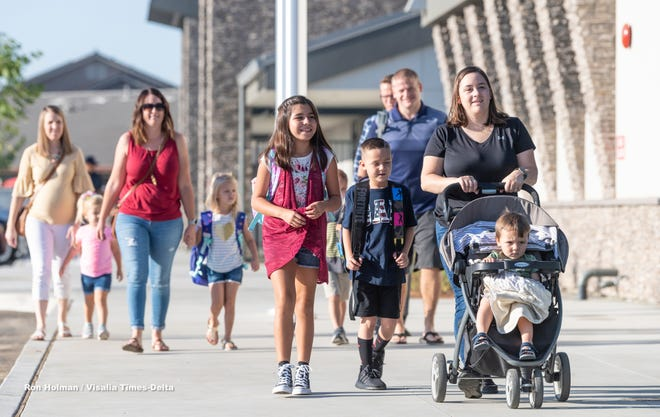 Families visit Denton Elemantary on the first day of school on Aug. 15, 2019. Denton is Visalia Unified's newest school. The district is currently planning the city's fifth high school and is seeking community input on the design.