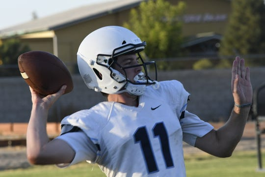 CVC quarterback Tyce Griswold passes the football during practice on Aug. 13, 2019 in Visalia.