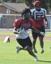 The Tulare Western High School football team practices on Aug. 12, 2019 in Tulare.