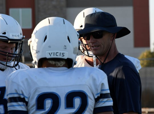 Central Valley Christian head football coach Mason Hughes talks to his players during practice on Aug. 13, 2019 in Visalia.