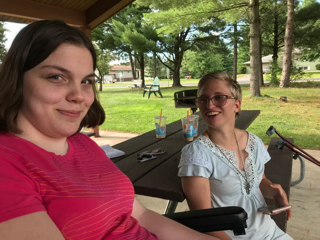 Cassidy Jansen (left) and Elizabeth Blenker (right) bonded as young girls in the physical therapy sessions they did together to stave off the effects of cerebral palsy.