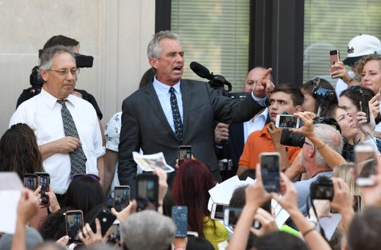 Attorneys Michael H. Sussman and Robert F. Kennedy, Jr. speak after a hearing challenging the constitutionality of the state legislature's repeal of the religious exemption to vaccination on behalf of New York state families who held lawful religious exemptions, during a rally outside the Albany County Courthouse Wednesday, Aug. 14, 2019, in Albany, N.Y. (AP Photo/Hans Pennink)