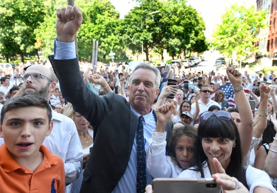 Attorney Robert F. Kennedy, Jr. poses for photographs with fans after speaking at a hearing challenging the constitutionality of the state legislature's repeal of the religious exemption to vaccination on behalf of New York state families who held lawful religious exemptions, during a rally outside the Albany County Courthouse Wednesday, Aug. 14, 2019, in Albany, N.Y. (AP Photo/Hans Pennink)