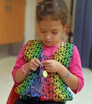 Ora Goldgrab, 6, practices button up a shirt during a program that help kids with hemispheric mobility issues to use their weak side at Blythedale Children's Center in Valhalla Aug.14, 2019.  Goldgrab suffered a stroke in utero.