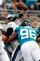 Jaguars' Datone Jones tackles Eagles' Cody Kessler as he tries to throw a pass Thursday in Jacksonville, Fla. Kessler was injured on the play.