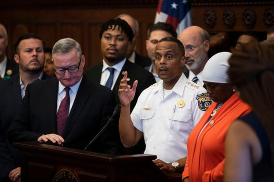 Philadelphia Police Commissioner Richard Ross, center right, speaks during a news conference at City Hall in Philadelphia, Thursday.