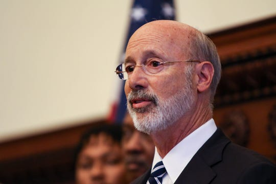 Pennsylvania governor Tom Wolf calls for increased gun control in response to the recent police shooting at a press conference with Pennsylvania politicians at the Philadelphia City Hall on Thursday, Aug. 15, 2019.