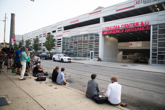 Members of the media wait outside the trauma center at Temple University Hospital after six Philadelphia Police Officers were shot Wednesday afternoon. The suspect was apprehended early Thursday morning after a long standoff with police on North 15th Street.