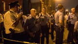 Scenes from a police standoff in Philadelphia where six police officers were shot Wednesday afternoon.