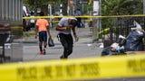 Philadelphia's Tioga-Nicetown neighborhood, where six Philadelphia police officers were shot Wednesday, slowly returned to a bustling street.