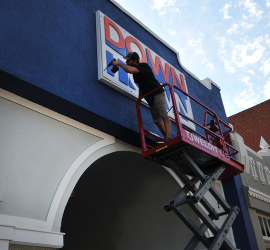 TTJWELDIT owner, TJ Johnson installs a new Downtown Wichita Falls Development sign at their new offices located on Indiana Avenue, Thursday morning.