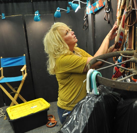 Bull Creek Cinches and Tack, owner, Tara Detherow prepares her booth for the annual Texas Ranch Round.