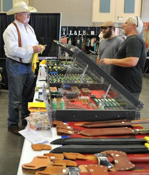 Wine Glass Cowboy Supply, owner, Doc Darnell prepares his booth for the 39th annual Texas Ranch Roundup, Thursday afternoon. The festivities begin at 9 A.M, Friday and wrap up at 10 P.M, Saturday, with a $5 ticket per person, per day.