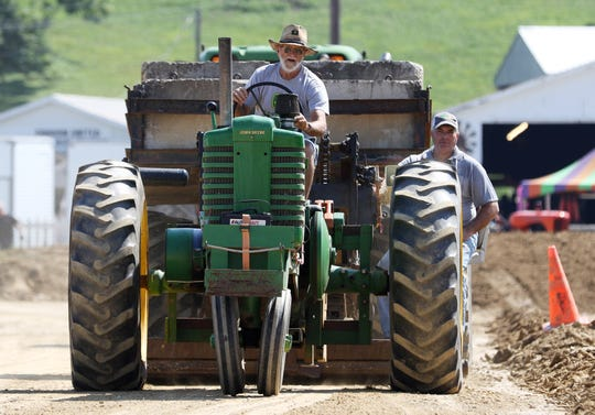 The antique tractor pull at the Muskingum County Fair on Thursday.