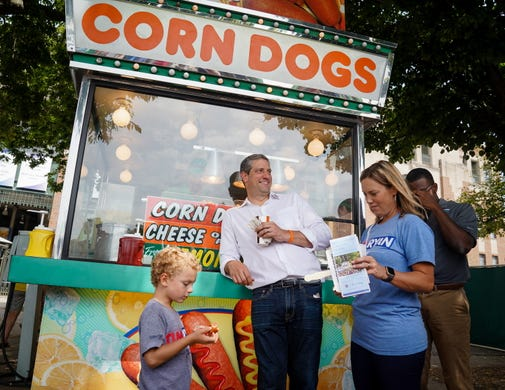 Democratic presidential candidate Rep. Tim Ryan, D-OH, enjoys the Iowa State Fair with his family after speaking on the Des Moines Register Political Soapbox on August 10, 2019.