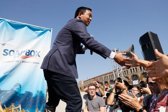 Democratic presidential candidate and entrepreneur Andrew Yang greets supporters before speaking at the Des Moines Register Soapbox during a visit to the Iowa State Fair, Friday, Aug. 9, 2019, in Des Moines, Iowa.