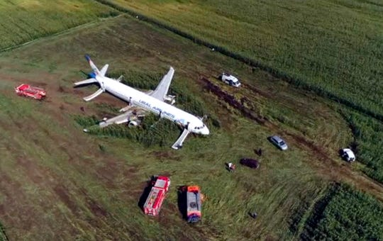 In this video grab provided by the RU-RTR Russian television, a Russian Ural Airlines' A321 plane is seen after an emergency landing in a cornfield.