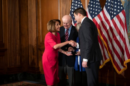 Rep. Seth Moulton (D, MA) greets House Speaker Nancy Pelosi (D, CA) before being ceremonially sworn in to Congress on January 3, 2019 in Washington D.C.