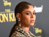 """(FILES) In this file photo taken on July 9, 2019, US singer/songwriter Beyonce arrives for the world premiere of Disney's """"The Lion King"""" at the Dolby theatre in Hollywood. - The Bey Hive was feeling the love on July 19, 2019, over Beyonce's release of the album """"The Lion King: The Gift,"""" which the pop queen dropped as a sister piece to the new Disney film she stars in. Beyonce dubbed the 27-track album she curated and produced """"a love letter to Africa,"""" enlisting several African artists as well as a star-studded cast including her husband Jay-Z, Kendrick Lamar, Childish Gambino, Pharrell and Tierra Whack -- along with none other than Jay and Bey's 7-year-old daughter Blue Ivy Carter -- as collaborators. (Photo by Robyn Beck / AFP)ROBYN BECK/AFP/Getty Images ORG XMIT: Beyonce r ORIG FILE ID: AFP_1IX9ZL"""