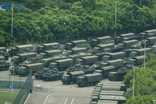 Chinese military trucks and tanks line up on the border with Hong Kong on Aug. 15, 2019.