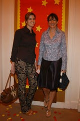 """Sarah Kellen (left) and Ghislaine Maxwell attend Madonna Childrens Book """"Lotsa de Casha"""" published by Callaway Arts and Entertainment at Bergdorf Goodman on June 7, 2005 in New York City."""