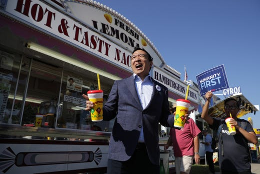 Democratic presidential candidate Andrew Yang buys lemonade for some of his staff and supporters during the Iowa State Fair on August 9, 2019.