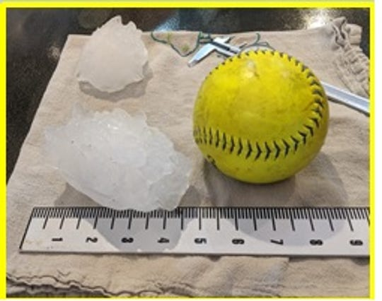 The biggest hailstone in Colorado state history (left) was almost as large as a softball (right).