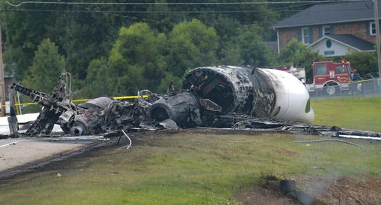 The burned remains of a plane that was carrying NASCAR television analyst and former driver Dale Earnhardt Jr. lie near a runway on Aug. 15, 2019, in Elizabethton, Tenn.