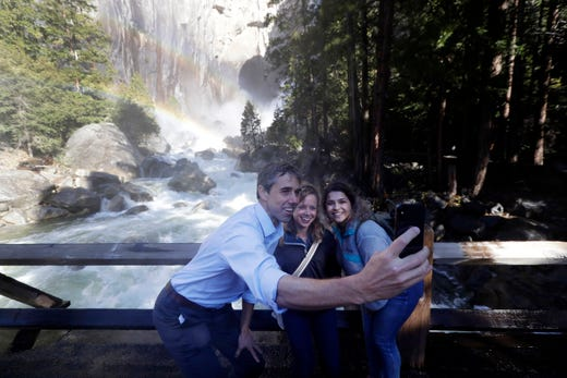 Democratic presidential candidate and former Texas congressman Beto O'Rourke, left, takes a selfie with Anne Kelly, center, Director of the Sierra Nevada Research Stations and environmental advocate Leslie Martinez, in Yosemite National Park on April 29, 2019.