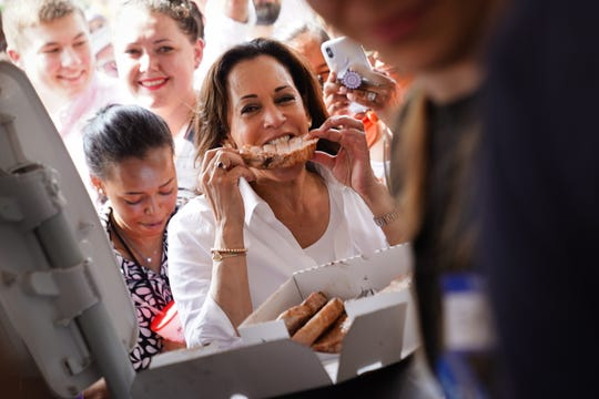US Senator and Democratic presidential candidate Kamala Harris eats a pork chop at the Iowa State Fair on August 10, 2019.