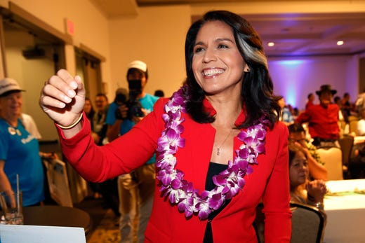FILE - In this Nov. 6, 2018, file photo, Rep. Tulsi Gabbard, D-Hawaii, greets supporters in Honolulu on November 6, 2018.