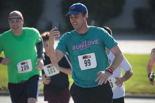 Democratic presidential candidate and former Texas congressman Beto O'Rourke nears the finish line in the Pride Fest Fun Run 5K on June 08, 2019 in Des Moines, Iowa.