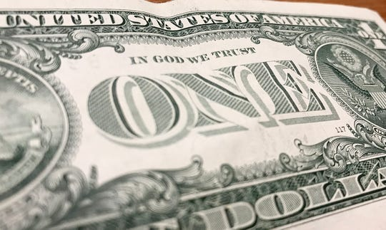 """Fayette County Schools are using dollar bills to satisfy Kentucky's new """"In God We Trust"""" motto-display requirement for public schools."""
