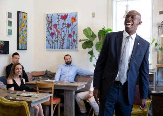 Mayor of Miramar, Florida and Democratic candidate Wayne Messam laughs as he is introduced to members of the New Hampshire Young Democrats at A&E Coffee / Apotheca Flower and Tea Shoppe in Goffstown, New Hampshire on May 21, 2019.