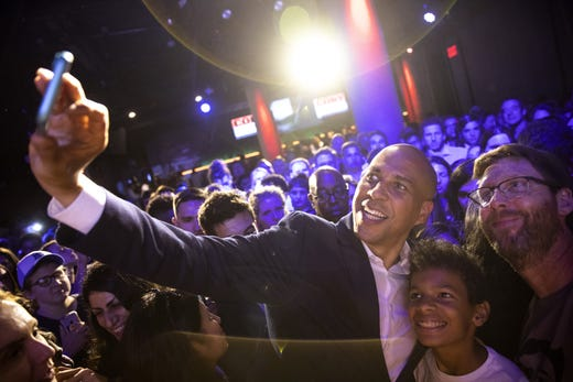 Democratic presidential candidate, Sen. Cory Booker, D-NJ, poses for photos with supporters at a campaign fundraising event at the nightclub Slate in the Flatiron District on August 12, 2019 in New York City.