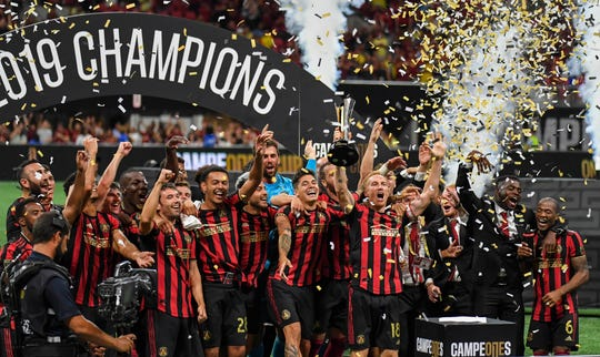 Atlanta United players celebrate after capturing the Campeones Cup with a 3-2 win over Club America at Mercedes-Benz Stadium.