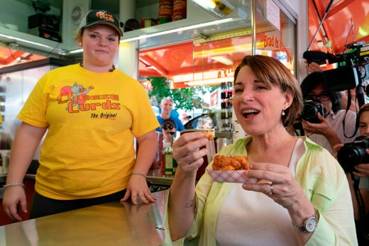 Democratic presidential candidate Amy Klobuchar eats Cheese Curds during her visit to the Iowa State Fair on August 10, 2019.