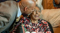 Vincent Tucker plants a kiss on Carol Tucker Jones during her 88th birthday celebration in Hampton, Va. on Sunday, March 31, 2019.