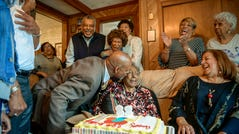 Vincent Tucker plants a kiss on Carol Tucker Jones during her 88th birthday celebration in Hampton, Va. on Sunday, March 31, 2019.