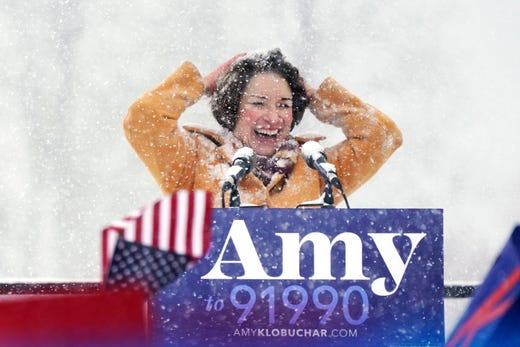 U.S. Sen. Amy Klobuchar wipes snow from her hair after announcing she is running for president on Feb. 10, 2019 in Minneapolis.