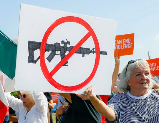Demonstrators demanded stricter gun-control measures in Dayton, Ohio, days after nine people died in a shooting there.