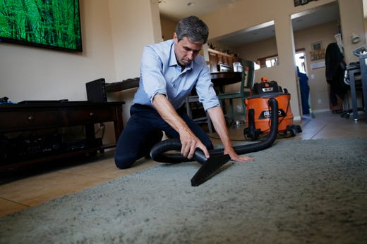 "Democratic presidential candidate and former Texas Rep. Beto O'Rourke vacuums a floor while following home care worker April Perales around during a Service Employees International Union ""Walk A Day In the Shoes"" event on August 1, 2019."
