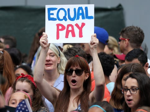 Fans in Manhattan chant for equal pay as they wait for the USWNT during the ticker-tape parade for the World Cup champions last month.