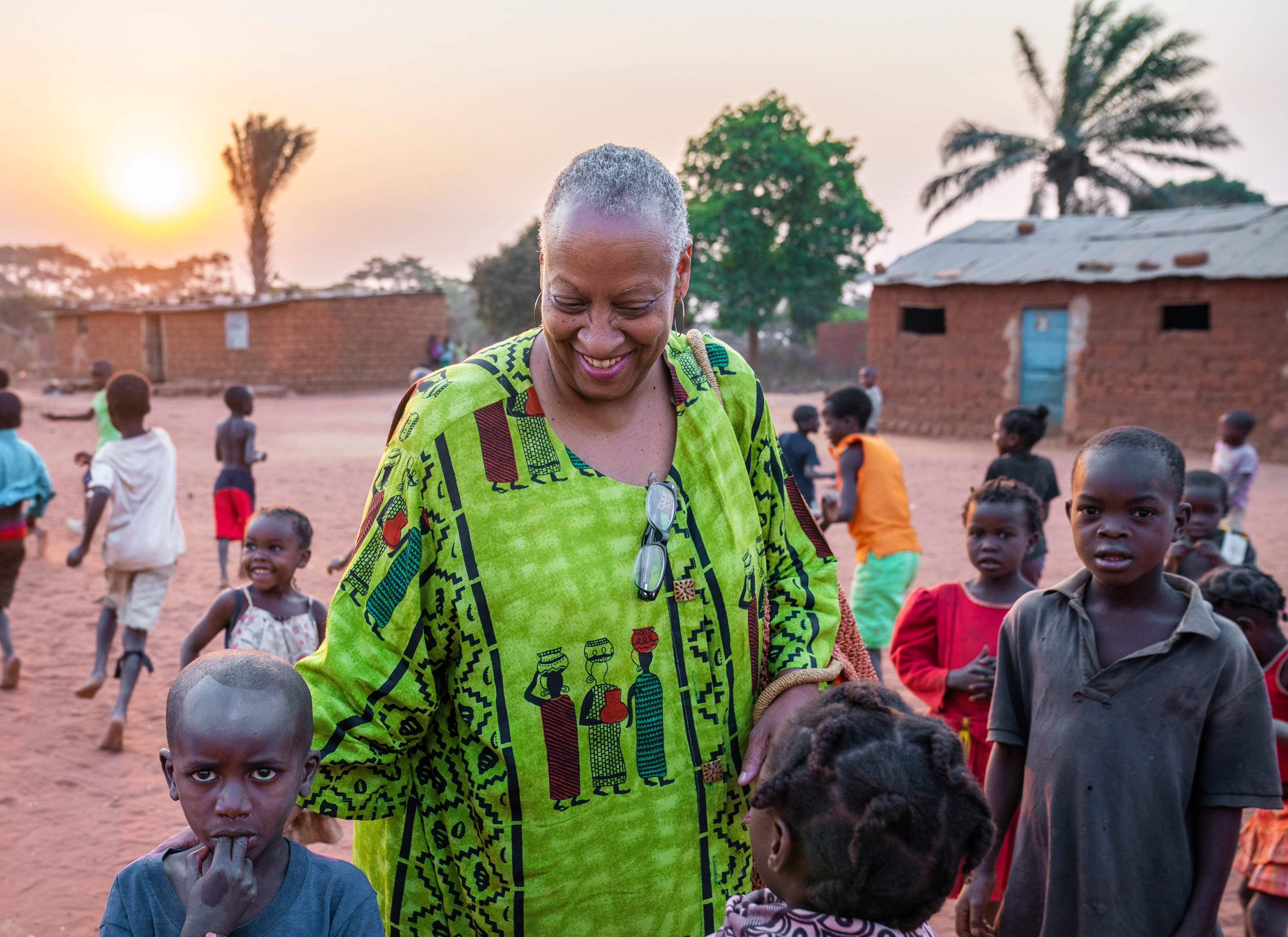 Children flocked to Wanda Tucker in a village in Kalandula, Angola, more than 200 miles east of the capital of Luanda. The village welcomed Wanda like a lost relative. Wanda believes her ancestors came from the Ndongo kingdom, whose descendants still live in approximately this part of Angola.