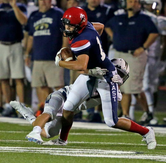 Spencer Meyer of Appleton East tries to break loose from a tackle attempt by Tyler Birling of Appleton North during a game last September in Appleton.