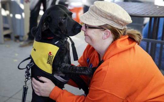 Judi Long visits with Tammy during Dogtoberfest as adoptable dogs from the Fox Valley Humane Association are shown last year at Fox River House in Appleton. FVHA is seeking donations as it is currently overcrowded with animals.