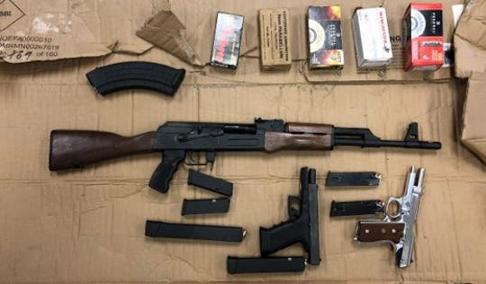 Asbury Park police officers confiscated a number of weapons and ammunition after a raid on a home on Elizabeth Avenue.