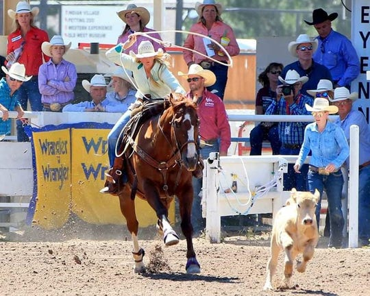 Katie Davis, an Ovalo resident, competes in a calf roping competition. Davis is also a full-time teacher, working for the online school Texas Virtual Academy at Hallsville.