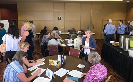 Residents filled out surveys and provided feedback about tourism during an Aug. 15 forum hosted by the Buncombe County Tourism Development Authority for its Tourism Management and Investment Plan.