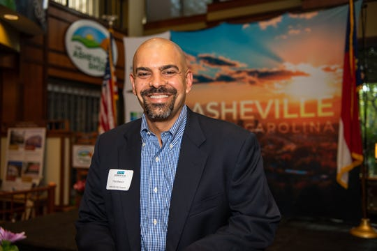 Asheville City Councilman Vijay Kapoor is among the local and state elected officials at the Asheville Area Chamber of Commerce's meet-and-greet on Aug. 15, 2019.